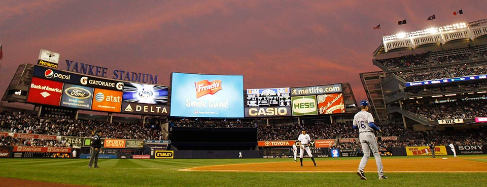 Yankee Stadium is bathed in an orange glow from the sunset