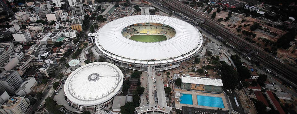 An aerial view shows the final touches of the roof installation at the Maracana Stadium